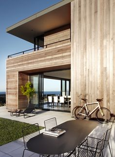With time, the strong coastal light will cause the timber to fade like a piece of driftwood, and the house will settle into the harsh landscape. The garden has been planted in a scrubby coastal style, using species from the immediate surroundings, and will mature and evolve over time.SMART DESIGN STUDIO - HOUSES