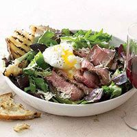 Whats quick and hearty? Thin slices ofgrilled steak with garlic crostini, parmesanand a poached egg on a bed of mixed greens.