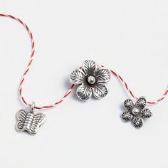 Set mărțișoare din argint: fluturaș, floare, floricică