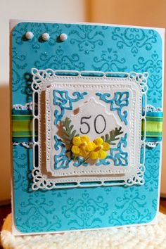 This designer paper has glitter in it. Used S n'S stamp for the number 50.