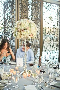 Tall centerpiece for ice hot or new vintage like the sliver of the center piece would go good with white