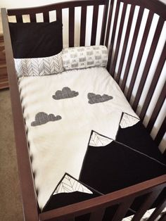 Mountain Blanket woodland baby crib quilt by SleepingLakeDesigns. Fun offshoot from woodland nursery bedding decor theme. I love the cute clouds on the blanket and the monochrome black and white.