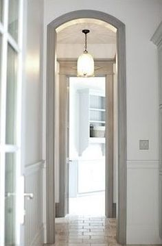Finally...a photo of cream walls and grey trim.  I like it.