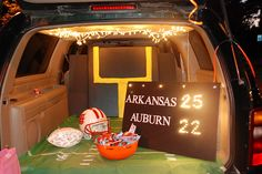 Wow, christmas lights stuck in a board (foam board or cardboard) into the number shapes. Football goal, helmet, football and green grass base. LOVE IT! For any college or school theme. Trunk or Treat by ldavisphotography, via Flickr