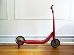 Vintage 50's Red Kick Scooter by Radio Line. // I had one of these! only it was blue, and had a section of 2x4 screwed-in where the handles should be because the handles broke DECADES before I was even born, lol. It was the BEST. SCOOTER. EVER.