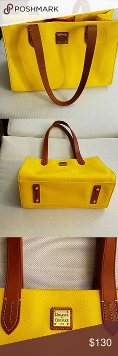 *WEEKEND SALE* Dooney&Bourke shoulder bag NWOT. Fun yellow leather Dooney & Bourke shoulder bag! Never used, in perfect condition! Snap closure with a fun red inside with lots of inside compartments. 11 inches across and 8 inches vertically. Dooney & Bourke Bags Shoulder Bags