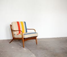 Gather & Collect. Vintage chair restored with wool blanket.