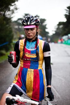 There's so much to say here: the Tecate beer in her hand, the pig tails, the dress that proudly declares her love of wieners, the fact that it looks like a circus tent. But mostly its her reverence toward the mud.