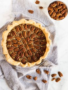 This is the best pecan pie recipe. Every bite is gooey and crunchy with a buttery, flaky crust. The perfect dessert for Thanksgiving! | www.ifyougiveablondeakitchen.com