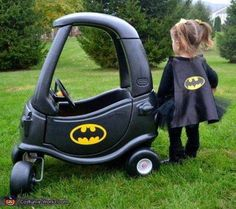 Paint an old COZY COUPE to look like the BATMOBILE for this fun Batman Costume....Love this idea! Featured on our BEST Homemade Halloween Costumes for Babies & Kids!  http://kitchenfunwithmy3sons.com/2015/09/37-of-best-diy-homemade-halloween.html/