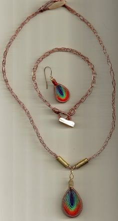 Viking Knit Maille, in copper with handwoven silk rainbow pendants, mother of pearl toggles