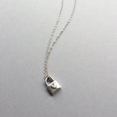"""Pure Silver Padlock handmade with love! This lil'cutie hangs on a sterling silver chain on your choice from 15""""-17"""". A classic modern style piece! ($60) #padlock #daintynecklace #charmnecklace"""