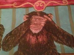 circus monkey close-up, see no evil.