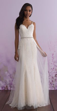Allure Romance wedding dress style 3110. Details so pretty, you'd be swooning at first sight! This intricately textured wedding dress features delicately embellished straps, a beaded belt and and the dreamiest tulle overskirt. #AllureBridals #AllureRomance #wedding #bridal #weddingdress #weddinggown #romantic #lace