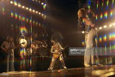 Bassist John Paul Jones, drummer John Bonham (partially hidden) , lead guitarist Jimmy Page and lead singer Robert Plant (front) of the English rock band Led Zeppelin performing on June 14, 1977 in New York City.