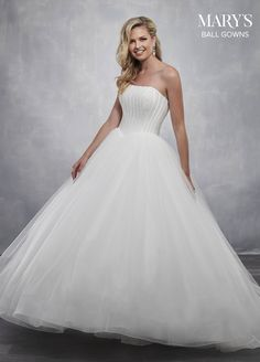 cd822a77320b5 Glittering strapless tulle ball gown with a fully beaded bodice, exposed  satin boning and a