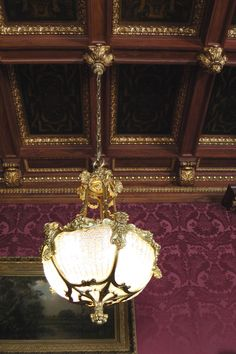 WHITE HALL.  Still in the Library – the lighting and ceilings in Whitehall are fabulous. The library a perfect combination of warm mahogany paneling up to about 6′ with aubergine damask above and gold leaf embellished ornamentation.