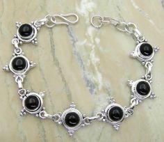 11.20ctw Genuine Black Onyx & .925 Sterling Silver Plated Brass Bracelet (SJHB0011BO) #silverbracelets #braceletsilver #braceletdesigns #sterlingsilverbracelets #silverbraceletsforwomen #braceletsformen #sterlingsilvercharmbracelet #bracelet #personalizedbracelets #gemstonebracelets #handmadebracelets #silvercharmbracelet Buy Now: http://www.sterlingsilverjewelry.tv/genuine-black-onyx-silver-plated-brass-link-bracelet-sjhb0011bo.html