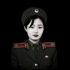 North Korea DPRK 북한 :: She's called Kim i-Sim, lives in Pyongyang (평양); she is dressed in uniform but she is not a soldier, she is the french speaking guide the 'Victorious Fatherland Liberation War Museum'. Photo by  Eric Lafforgue.