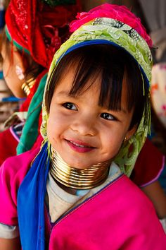 Thailand | Portrait of a Kayan or Padaung hill tribe girl, more commonly known as the long-neck or giraffe tribe due to brass coils worn around their necks, located in a small village in the Chiang Mai Province  | © Kimberley Coole