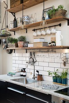 Open shelving with hooks for hanging mugs and kitchen tools.