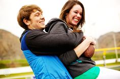 Creative Engagement Session Ideas | Football Keep-away | Golden, CO | See more Engagement Session Ideas here http://www.oneone.co