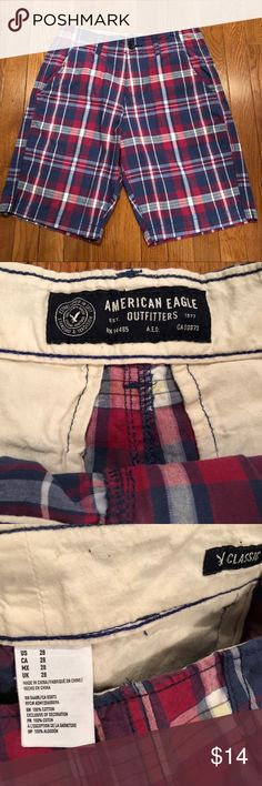 Men's Classic Red Checkered Khaki Shorts - 28 Men's American Eagle Classic Fit Khaki Shorts in size 28, Red, white and blue checkered and in Excellent Condition and perfect for spring/summer!  No holes, tears, rips or stains.  Comes from a very clean, smoke-free home.  No Filters are used to take photos.  I strive to ship on the same day or next.  I try to describe my items honestly and price them fairly for positive feedback. Feel free to make an offer or ask any questions. I'm happy to…