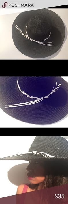 Braided Floppy Beach Hat Braided in black in white for a touch of chicness. Amazing style for spring break and vacation season. All merchandise is from my storefront and online boutique. GlitterBuzzStyle Boutique Accessories Hats
