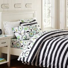 Maybe navy blue or grey bedding?
