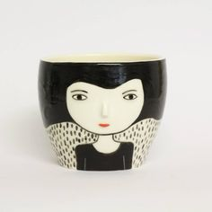 Kinska is a ceramics shop making my favorite types of porcelain pieces: face pots. There's something so great about plants growing out of someone's noggin.