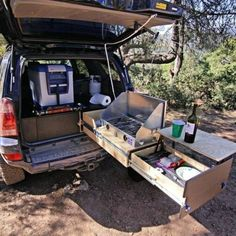15 SUV Camper Conversion Ideas That'll Blow your Mind – GODIYGO.COM Suv camper has a bed frame with an abundance of storage underneath, a kitchen unit with a sink, many handy places for extra storage, a back-up camera, and much Suv Camping, Camping Hacks, Luxury Camping, Camping Table, Camping Guide, Outdoor Camping, Kombi Motorhome, Camper Trailers, Campervan