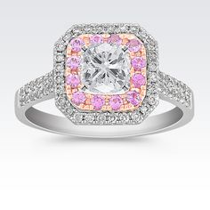 This modern and fashionable engagement ring is crafted from quality 14 karat white and rose gold, features 56 round pavé-set diamonds, at approximately .29 carat TW.  Fourteen round pavé-set pink sapphires, at approximately .23 carat TW, provide the perfect accent.  Simply add the center stone of your choice of approximately 1.00 carat.  Please contact a customer service representative for additional information or questions regarding your center stone selection.  The total gem...