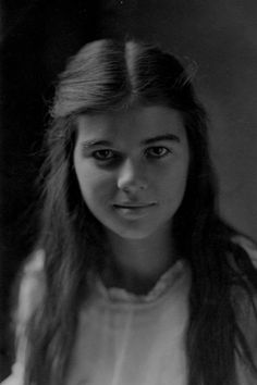 Smiling Victorians/Edwardian  Beautiful young lady.