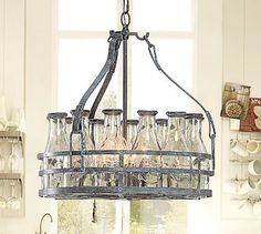 Shop milk bottle chandelier from Pottery Barn. Our furniture, home decor and accessories collections feature milk bottle chandelier in quality materials and classic styles. Beer Bottle Chandelier, Bottle Lights, Farmhouse Chandelier, Kitchen Chandelier, Kitchen Lighting, Rustic Chandelier, Old Milk Bottles, Milk Jars, Wine Bottles