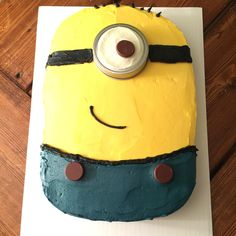#Minion Cake made with homemade icing (with real butter) a York Peppermint Patty covered in frosting and a Hershey Kiss, and a canning jar lid for the eye. There are two kisses for the suspenders.  #minioncake