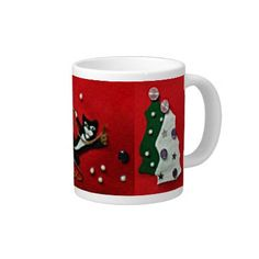 Jumbo mug with black and white tuxedo cat on red felt background, flanked by green and white felt Christmas trees. $22.45