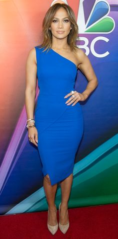 Jennifer Lopez proved that covering up can still look sexy—she struck a fierce pose at the 2016 NBCUniversal Press Day in a cobalt blue one-shoulder Victoria Beckham sheath dress that hugged her every curve. An assortment of rings, a stack of bracelets, and nude suede Casadei pumps completed her look.