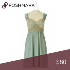 """NWOT Anthropologie Elding Slip Dress 0 Pale blue twill gleams beneath a gilded, filmy overlay on this Left of Center creation, styled with a pleated empire waist and slim straps.   Back zip Nylon, polyester lining  Beautiful ethereal dress perfect to dress sweetly or with a bit of edge. Muted blue-green under gold lace.   New without tags, never worn.  Approx measurements: Bust: 14"""" Length: 34"""" Anthropologie Dresses"""