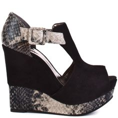 Snakeskin is so right now, and this style fits the bill.  Luichiny's Buckle Up will take you on a ride with its soft black upper, adjustable ankle strap and accents of snake print.  A 1 1/2 inch peep toe platform and 5 inch wedge finish this enticing sandal.