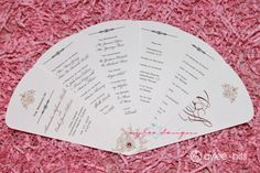 Picture of a white wedding program template against a pink background