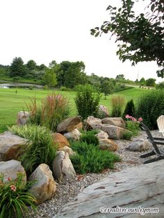 Pretty boulder garden border. Would be great at the far edge of the pond!