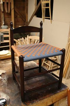 A Tappan Bar Stool shortened to serve as a weaving and spinning stool, with a navy and rust checkerboard weave Foot Stools, Bar Stools, Pub Design, Wishbone Chair, Spinning, Rust, Weave, Patterns, Furniture