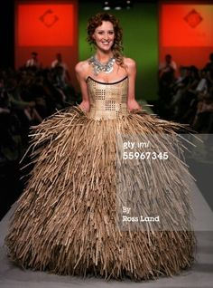 News Photo: model wears a Linda Lepou wedding dress named…