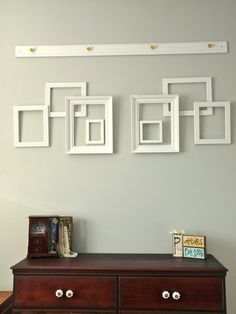 Created a empty frame wall using frames I found at a garage sale, cute flower knobs, fishing wire and a small strip of crown molding