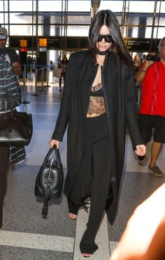 Wearing all black doesn't have to mean boring. Whether you want to elevate your nighttime style, or your go-to pants and blazer, get inspired by our favorite style stars who make the look anything but basic; Kendall Jenner.