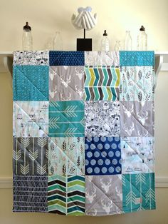 This Buck Forest Teal baby quilt is made from high quality cotton designer fabrics in grey, teal, turquoise, mint, navy, black, white and ivory -
