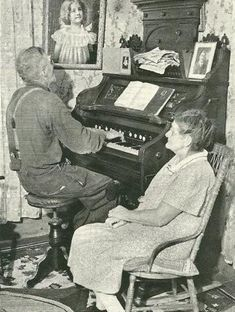 An old fisherman of Blue Rock, Nova Scotia, near Lunenburg, lives up to the line by Robert Louis Stevenson as he plays the organ for his wife in their cottage parlor. The man taught himself to play the instrument and on Sundays he is the church organist.