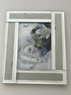 """Abstract Mirrored  Photo Frame With Crystal Inlay 4 X 6    Share those special moments with this modern photo frame.  It's perfect for letting your picture do the talking. A great addition to any home or office, the photo frame is a fabulous easy gift idea.  Features        Photo frame - modern and simple      Great for displaying those special moments and precious memories      Portrait      Fits picture size 4"""" x 6""""      Package Contents        1 x Photo frame      1 x white box    Frame…"""