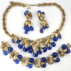 Trifari 'Alfred Philippe' Gold and Poured Glass Sapphire Berry Clusters Necklace Bracelet and Pendant Clip Earrings Set