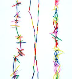 shunichiro nakashima - collection of brightly colored handmade jewelry made from feathers and pvc.
